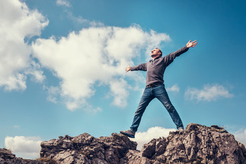 Man enjoy with freedom feel on the top of mountain