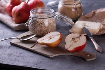 Healthy breakfast. Fresh granola in glass jar on a black stone background