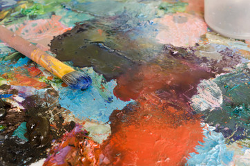 Oil paints and brush on palette. Abstract Background. Colorful t