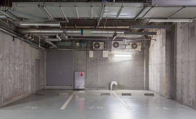 Parking garage underground interior, neon lights in dark..