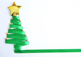 Beautiful fir tree made from satin ribbon, isolated on white
