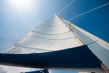 Sailing yacht in a smooth wind with sunny blue sky day