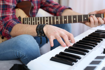 Man with guitar and synthesizer closeup