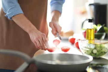 Man cooking dinner in kitchen