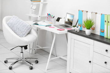 Stylish bright workplace in office