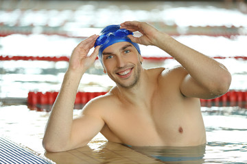 Sporty young man in the swimming pool