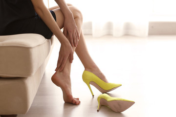 Woman in yellow high heels shoes.