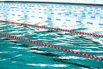Background of water and markers in the swimming pool