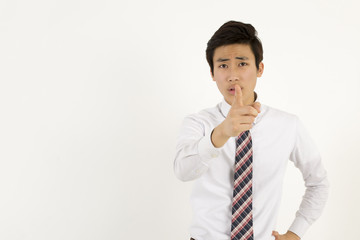Serious young businessman pointing at you with index finger