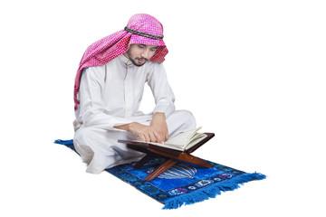 Arabic man reads Quran in studio