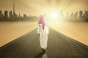 Arabic person walks on the road