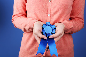 Woman with award ribbon. close-up