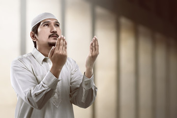Image of young muslim man praying