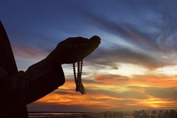 Image of silhouette man hand praying