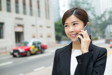 Businesswoman make a call on phone