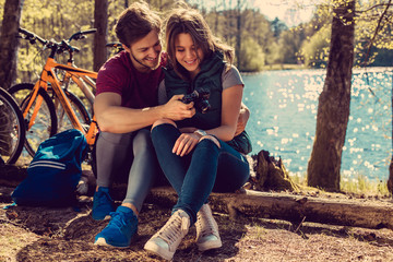 Loving couple taking pictures with smartphone.