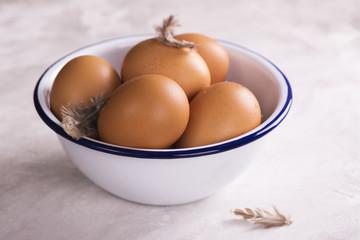 Fresh eggs in a metal bowl
