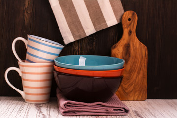 Kitchen cooking utensils with napkins over wooden table