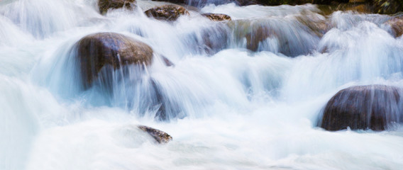 Close up of a waterfall during high water flow at springtime
