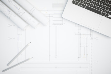 Desktop with architectural plan top