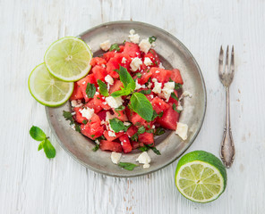 Fresh salad with water-melon, feta cheese, lime and mint.