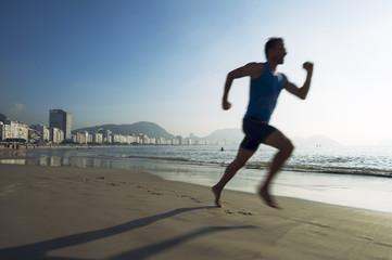 Silhouette of an athlete running on Copacabana Beach in Rio de Janeiro, Brazil