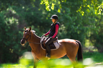 Young woman on a horse ride