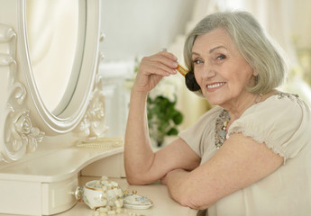 Senior woman with make up brush