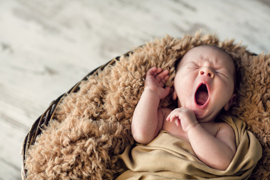 sweet newborn baby yawns