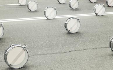 Drums on asphalt