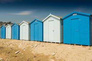 Blue beach huts in row