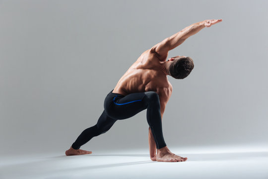 Handsome man doing yoga exercise
