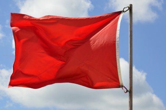 life guards red warning flag on the beach