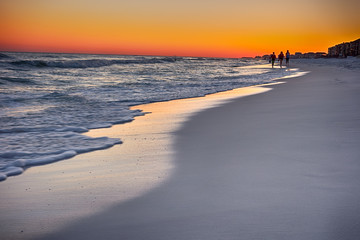 orange sunset over gulf of mexico at destin fl