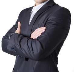 Силуэт бизнесмена в черном костюме, стоящего прямо, руки скрещены на груди.