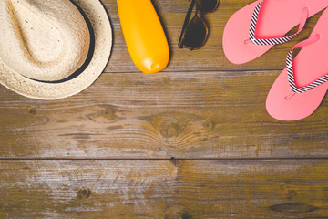 Summer accessories on an old wooden background