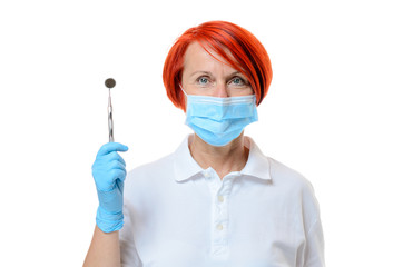Red headed dental assistant holding one tool
