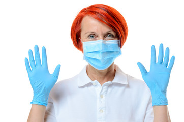 Close up of red headed nurse wearing face mask