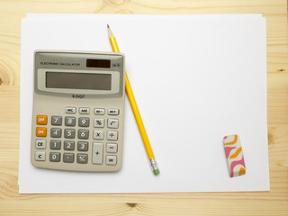 Calculator, blank paper, pencil and eraser