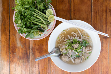 Vietnamese noodle (pho) on wooden table