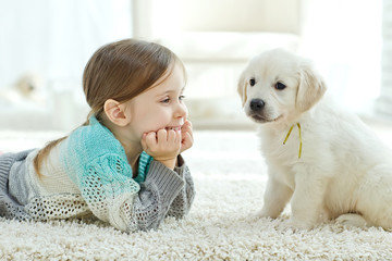 Kid with puppies at home