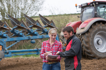 saleswoman try to sell new tractor to farmer