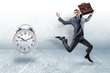 Business concept with businessman and clock
