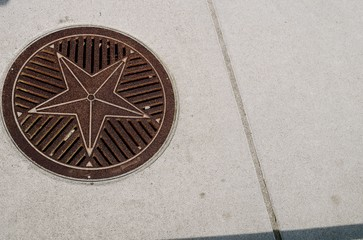 Decorative Manhole Cover / Attractive man hole cover decorated with a star.
