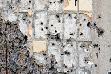 wall shattered with bullets