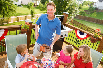 Summer: Dad Serves Up Hamburgers and Hot Dogs