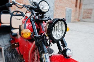 Headlight of old red retro motorcycle