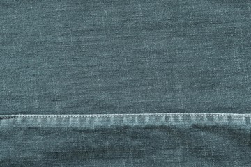 texture denim with the stitched seam of pale indigo color