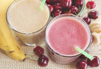 Cherry and banana and milk smoothie. Milkshake with cherries and bananas.