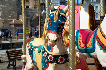 Bright vintage carousel in a French Honfleur.